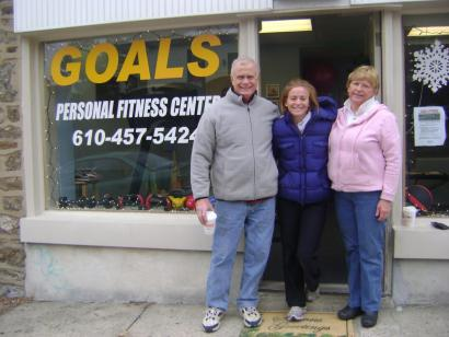 "Kasey Manwaring with her parents, Dennis and Gina outside of ""Goals Personal Fitness Center"" in Manyunk."