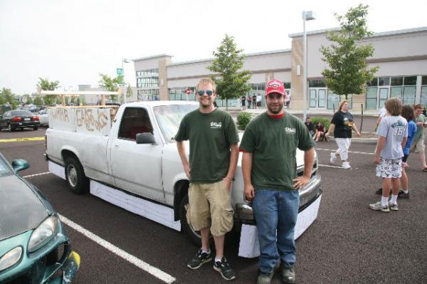 left to right: Geoff Gallo and Jamie Newman show off the '92 Dodge Dakota for WMMR's Ugliest Car Contest
